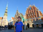 Bai Yuen (CSH MS '88) in front of the Blackheads House, a historic landmark in Riga, Latvia.
