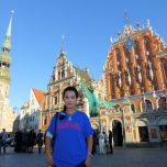 Bai Yuen (CSH MS '88) in front of the Blackheads House, a historic landmark in Riga, Latvia.