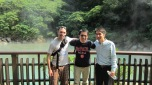 "Scott Polisky (BUS '12), Ying ""Robin"" Tsou (MBA '11) and Eddie Lin at the Beitou Thermal Valley Green Sulfur Spring in Tapei, Taiwan."