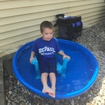 Jason Wagner, the son of Katherine Stone (CSH '00), beating the heat in his backyard.