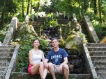 Joseph Weiss (LAS '08) with his wife, Claire, at the base of the Fonte Fria in Buçaco Forest in Portugal.