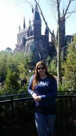 DePaul staff member Melissa Smith (LAS MA '12) outside Hogwarts at Universal's Islands of Adventure in Orlando, Fla.