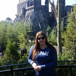 DePaul staff member Melissa Smith (LAS MA '12) outside Hogwarts at Universal's Islands of Adventure in Orlando, Fla.