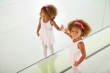 Little ballerina in dance studio