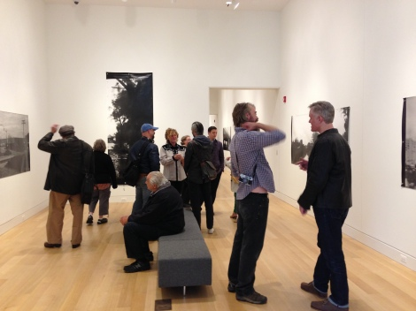 "Guests mingle during the ""Liminal Infrastructure"" opening reception."