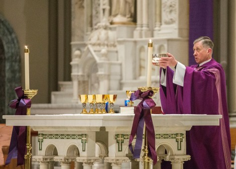 Archbishop Blase Cupich celebrates mass at St. Vincent de Paul Parish on March 8, 2015. Part of the digital records. Photo credit: Jamie Moncrief. Picked by Andrea Bainbridge.