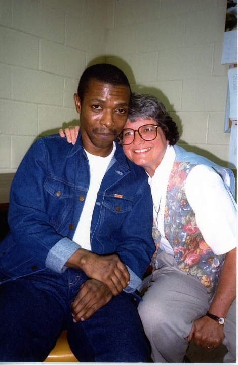 Dobie Gillis Williams and Sister Helen Prejeang (DHL '00) take a photo in his cell on death row in 1998. Picked by Morgen MacIntosh Hodgetts.