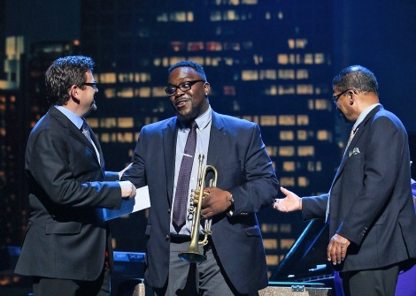 John Burk, chief creative officer at Concord Music Group, and jazz musician Herbie Hancock congratulate Marquis Hill at the 2014 Thelonious Monk International Jazz Trumpet Competition at Dolby Theatre in Hollywood, Calif. Photo credit: Imeh Akpanudosen/Getty Images for Thelonious Monk Institute of Jazz.