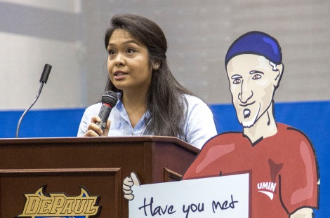 Student body president Vanessa Cadvillo greets the students as they arrive at the Sullivan Athletic Center Tuesday, Sept. 8, 2015, for New Student Service Day. Nearly 1200 incoming students participating in the Discover Chicago program wrapped up their week of immersion by volunteering with area non-profits and community groups as part of DePaul University's New Student Service Day. (DePaul University/Jamie Moncrief)