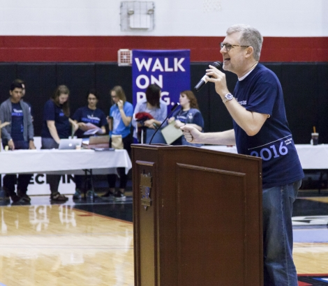 The Rev. Dennis H. Holtschneider, C.M., president of DePaul, greets volunteers as they gather for Vincentian Service Day at McGrath Arena, Saturday, May 7. (DePaul University/Deanna Williams)