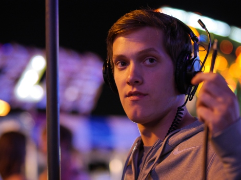 Boom operator Kyle Eskra prepares for a scene on location at the carnival. Photo credit: James Psathas