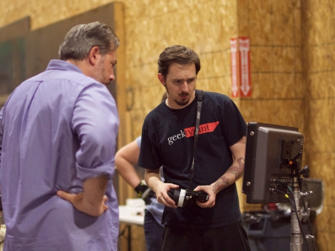 Assistant Professor John Psathas (CDM MFA '11) and Ryan Harvey (DEGREE) watch a scene on the monitor at Cinespace Chicago. Photo credit: Taylor Gillen