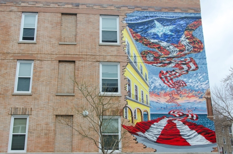 Murals on some of the Latin United Community Housing Association residential buildings allude to the story of its tenants. Photo credit: Megan E. Doherty