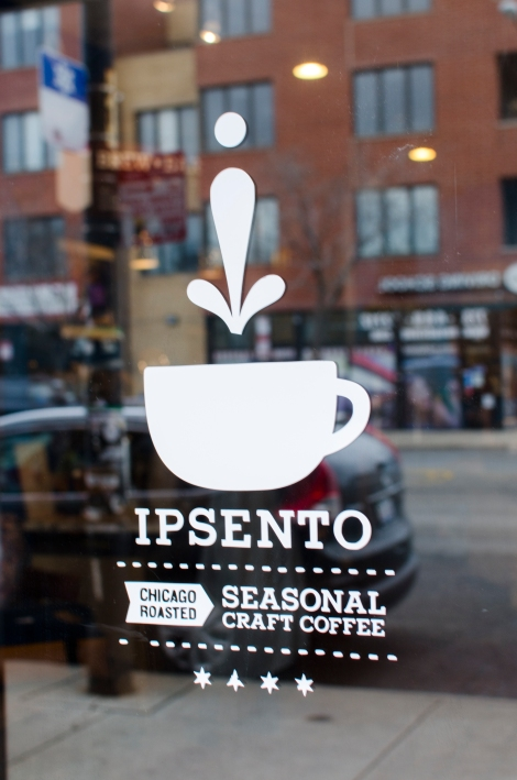 Ipsento's front window reflects the new retail development across the street. Photo credit: Megan E. Doherty
