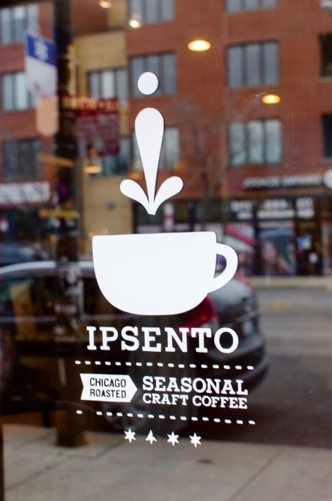 The window at Ipsento reflects the new retail development across the street. Photo credit: Megan Doherty