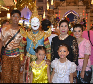 Chavez with her host family, wearing traditional Thai clothing.