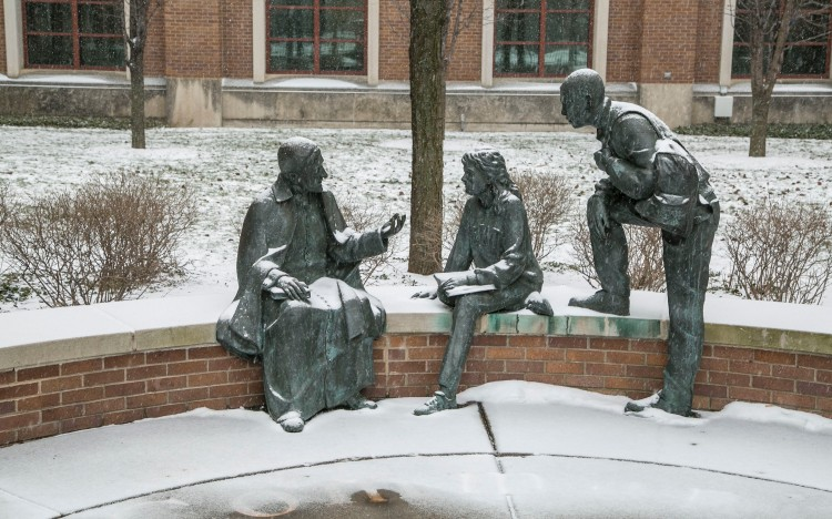 A light coating of snow falls upon the St. Vincent's Circle statue on DePaul University's Lincoln Park Campus Friday, Jan. 22, 2016.  (DePaul University/Jamie Moncrief)