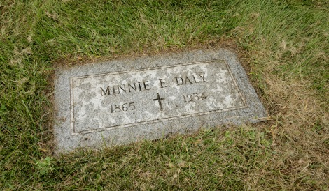 The grave marker of Minnie Daly, Saturday, Sept. 10, 2016, at Calvary Catholic Cemetery in Evanston. Minnie Daly, the first lay female graduate of DePaul in 1914, was buried in her sister's grave (Florence Daly) without any marker. DePaul recently provided a new grave marker to indicate the site of her burial. (DePaul University/Jeff Carrion)
