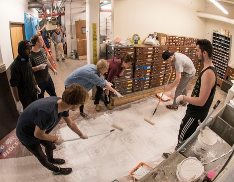 Students gather in a large Lincoln Park warehouse Friday, April 22, 2016, to prep the massive mural panels that will be displayed under the CTA's Fullerton 'L' stop during his class 'Mural Painting'. Throughout the spring 2016 quarter and into the summer, Br. Mark and his students will create several murals that will wrap the support columns underneath the CTA's Fullerton 'L' stop, which runs right through DePaul's Lincoln Park Campus. The murals will depict many prominent, historical figures that have made an impact on DePaul University. (DePaul University/Jamie Moncrief)
