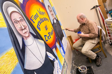 Brother Mark Elder, C.M., works quietly in the office-based attic at Levan Hall Friday, July, 15, 2016, as he puts the finishing touches on several of the murals, including one featuring DePaul's first female graduates, Sister Mary Teresita and Sister Mary Clemenza Leahy. The artwork will hang under the CTA's Fullerton 'L' stop. Throughout the spring 2016 quarter and into the summer, Br. Mark and his Mural Class students will create several portraits and historically-themed murals that will wrap the support columns underneath the CTA's Fullerton 'L' stop, which runs right through DePaul's Lincoln Park Campus. The murals will depict many prominent, historical figures that have made an impact on DePaul University. (DePaul University/Jamie Moncrief)