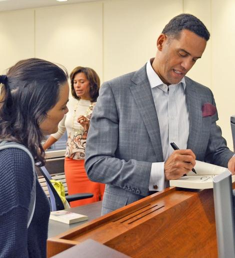Steve Pemberton signs his memoir for an Honors Program student.