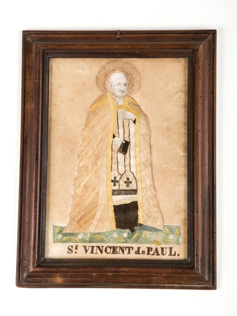 "A rustic, hand-embroidered portrait of St. Vincent de Paul is an example of the 19th-century craft, often practiced by young girls to improve their sewing skills. The item is from DePaul University's collection and is part of a special exhibition, ""The Many Faces of Vincent de Paul: Nineteenth-Century French Romanticism and the Sacred,"" at the DePaul Art Museum. (DePaul University/Jamie Moncrief)"