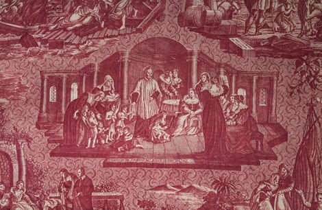 "This panel of fabric from the beginning of the 19th century depicts scenes from St. Vincent DePaul's life in five vignettes. Here, St. Vincent speaks to the Ladies of Charity about the plight of the children before him. The item is from DePaul University's collection and is part of a special exhibition, ""The Many Faces of Vincent de Paul: Nineteenth-Century French Romanticism and the Sacred,"" at the DePaul Art Museum. (DePaul University/Jamie Moncrief)"