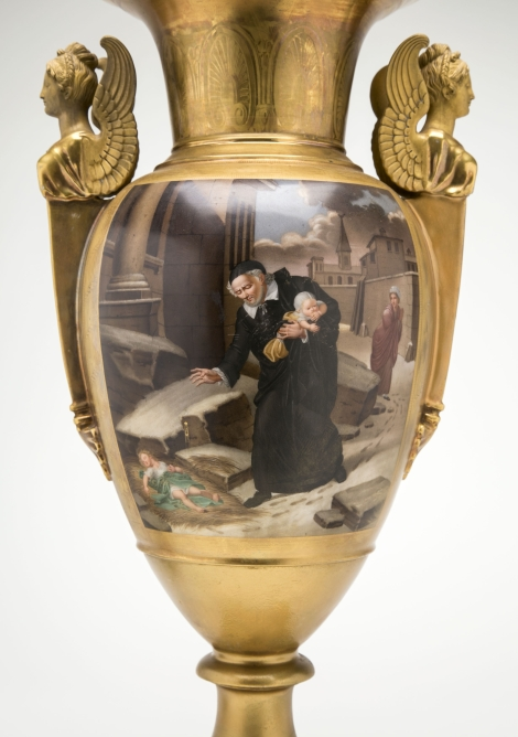 "A gilded urn from the mid-19th century pictures St. Vincent de Paul rescuing abandoned children from snowy streets. The item is from DePaul University's collection and is part of a special exhibition, ""The Many Faces of Vincent de Paul: Nineteenth-Century French Romanticism and the Sacred,"" at the DePaul Art Museum. (DePaul University/Jamie Moncrief)"