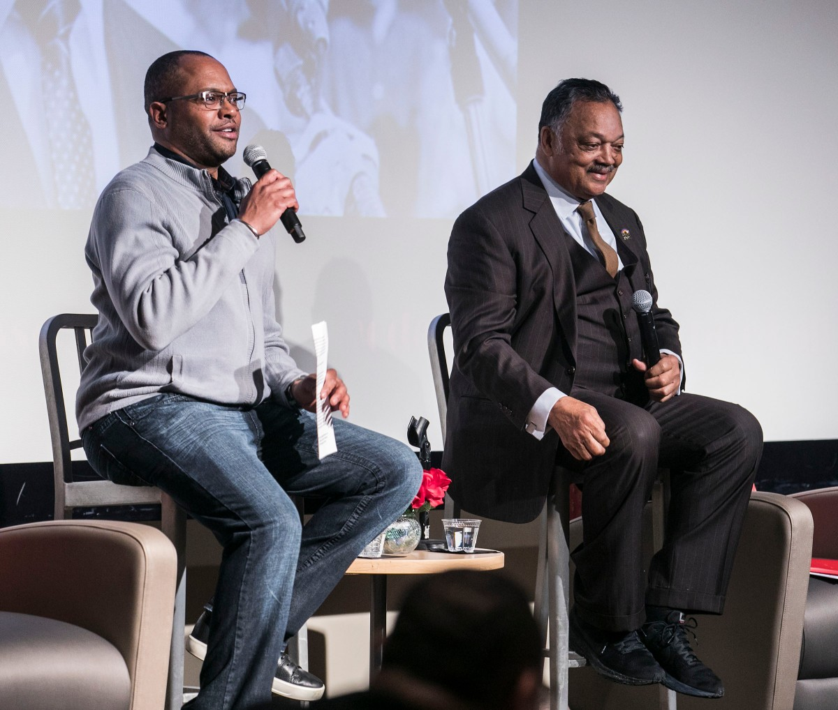 Moderator Horace Hall, associate professor in the College of Education, and the Rev. Jesse L. Jackson Sr.