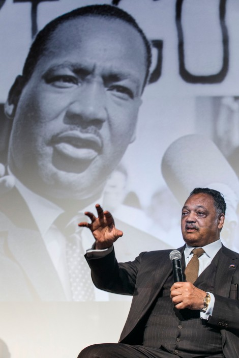 The Rev. Jesse Jackson Sr. speaking in front of a photo of the Rev. Dr. Martin Luther King Jr.