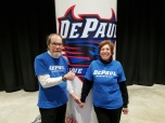 Elaine Feldman (MBA '81) and her husband, Norb Tatro, at a DePaul women's basketball game at Wintrust Arena.