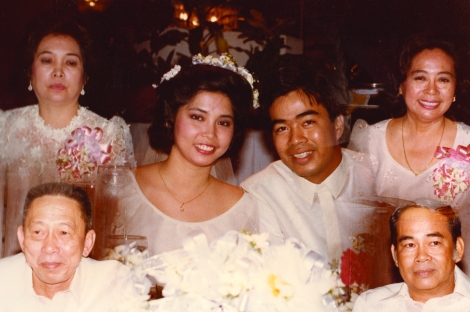 Photo of the Estebans at their 1985 wedding, flanked by their parents.