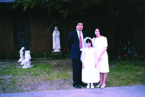 Photo of the Estebans at Ysabella's first communion in Arkansas, 1998.