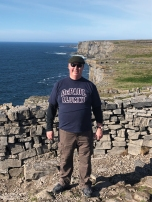 Michael O'Connor (LAS '92) among the ruins of Dùn Aonghasa, on the southern coast of the Aran Island of Ínís Mor, Ireland.