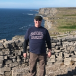 Michael O'Connor (LAS '92) among the ruins of Dùn Aonghasa, on the southern coast of the Aran Island of Ínís Mor, Ireland.